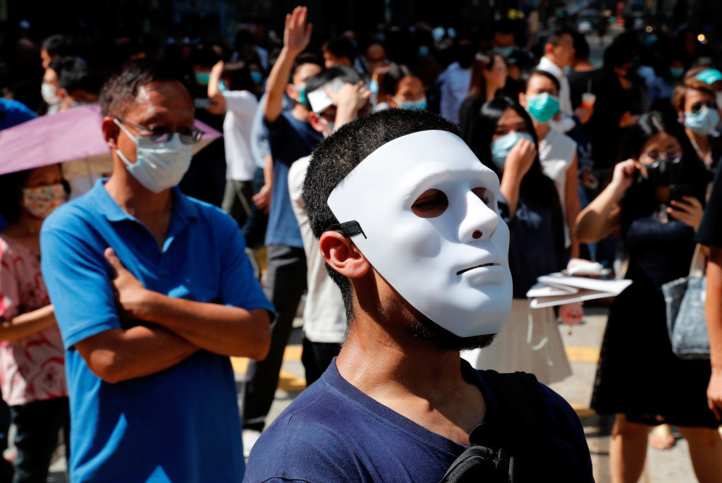 Masked Protesters in Hong Kong protest for the Expected Mask Ban