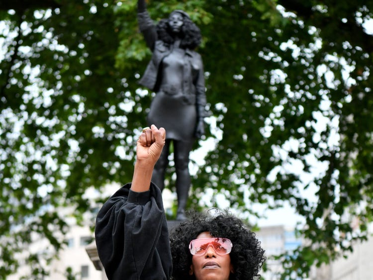 Toppled UK statue of slave trader quietly replaced with sculpture of Black Lives Matter protester